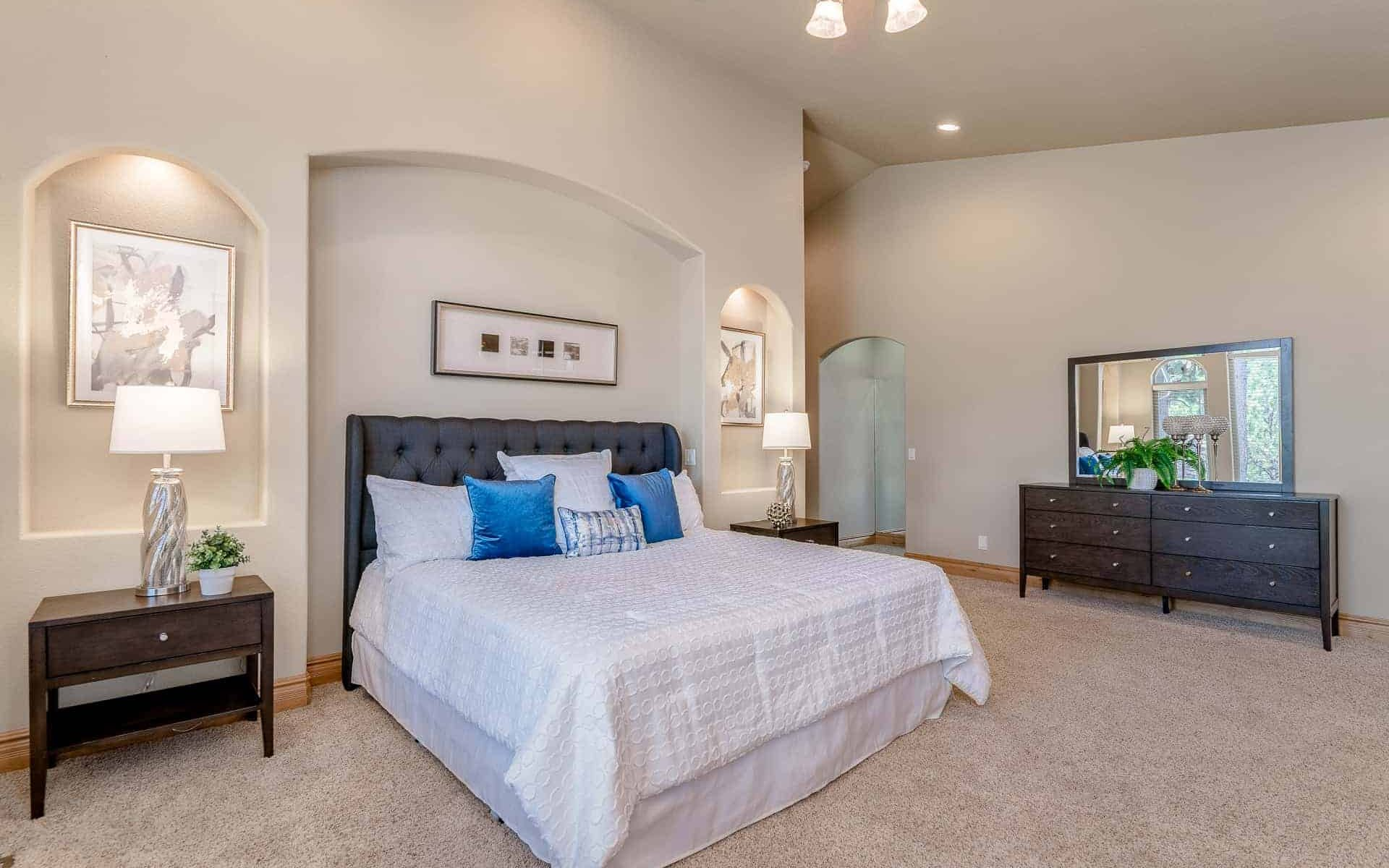beautifully staged master bedroom